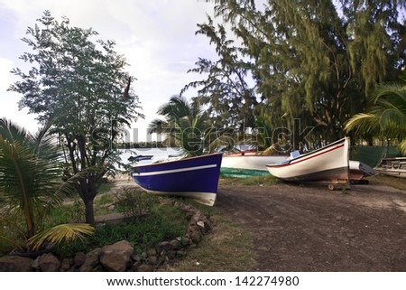 Rowboats on shore on Mauritius island - stock photo