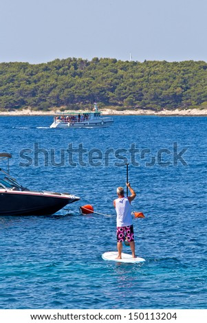 Rower practicing in the sea. Sunny weather, health, sports. Hvar. Croatia. High quality stock photo. - stock photo