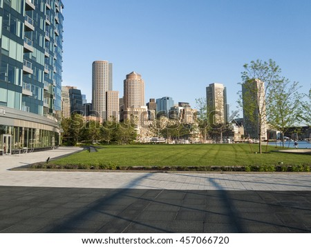 Rowes Wharf view across stretch of Fan Pier Park - stock photo