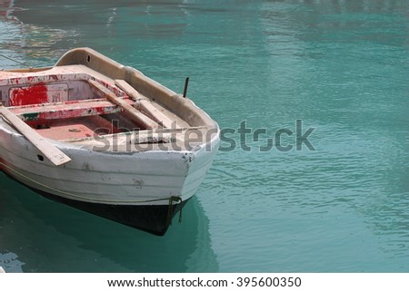 rowing boat and oars on the water - stock photo