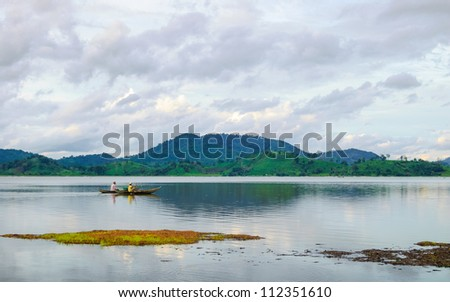 Rowing boat on Lak lake, Central Highlands of Vietnam - stock photo