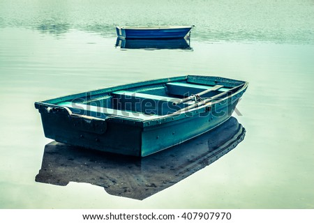 Rowing boat on the lake landscape, tranquil scene, vintage photo - stock photo