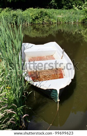rowing boat or small fishing boat for recreation moored.