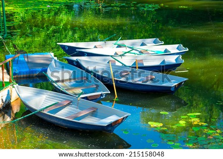 rowing boats in the pond in the early morning - stock photo