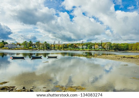 Rowing Boats on a River and an Awesome Autumnal Landscape - stock photo