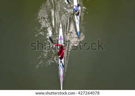 rowing race between man and woman. Gender equality - stock photo