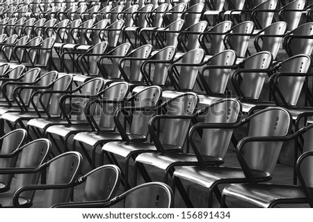 Rows of black metal chairs