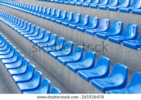 Rows of blue empty  plastic chairs or seats  at the tribune swimming pool or stadium - stock photo