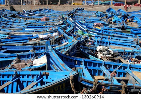 Rows of blue fishing boats in port of Essaouira, Marocco - stock photo