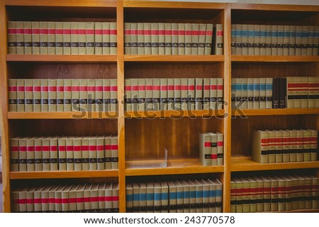 Rows of bookshelves in the library at the university - stock photo