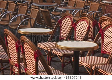 Rows of cafe tables and chairs at Place Plumereau in the old quarters of Tours in France.