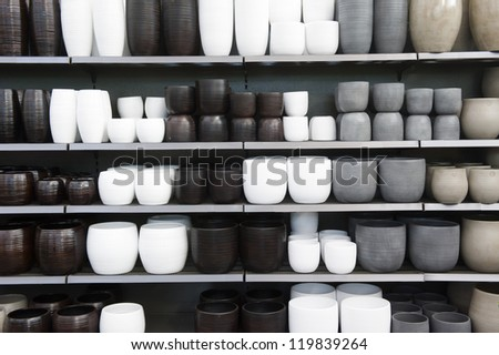 Rows of ceramics flowerpots in brown,grey and white