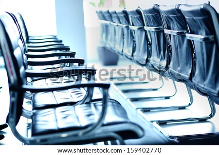 Rows of chairs in conference hall - stock photo