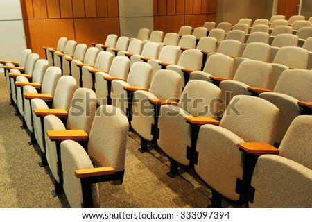rows of chairs in lecture hall - stock photo