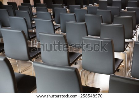 Rows of  chairs in the presentations hall