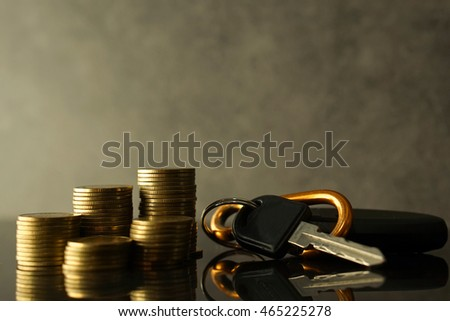 rows of coins and key of car for finance about car concept