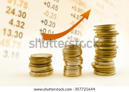 rows of coins on display of Stock market - stock photo