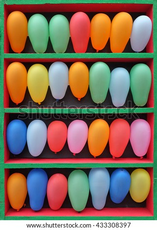 Rows of Colorful Balloons Arranged for an Arcade Skill Game, Throwing game on fair
