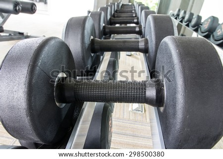 Rows of dumbbell in the gym - stock photo