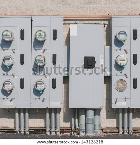 rows of electric meters in the back side of supermarket or strip mall - stock photo