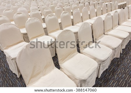 rows of empty grey seating at an event