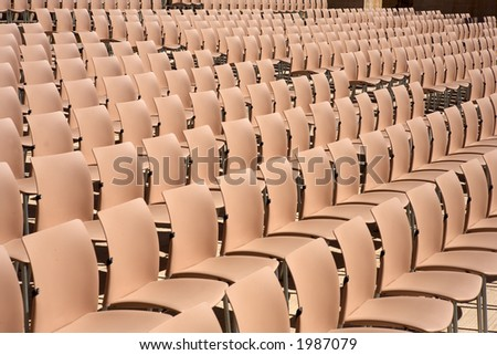 rows of empty plastic seats at the alhambra palace granada spain andalucia - stock photo