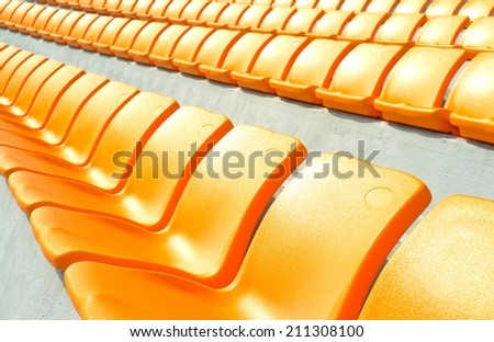 rows of empty stadium seats - stock photo