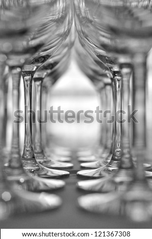 Rows of Empty Wine Glasses on the table - stock photo