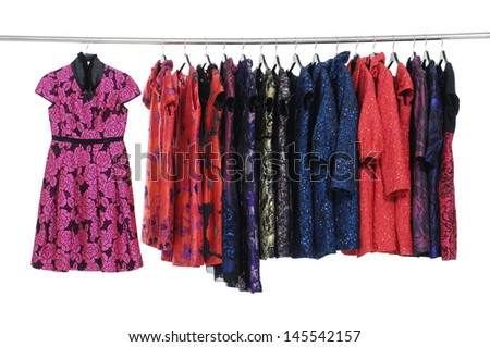 Rows of evening gown on a clothesline hanging