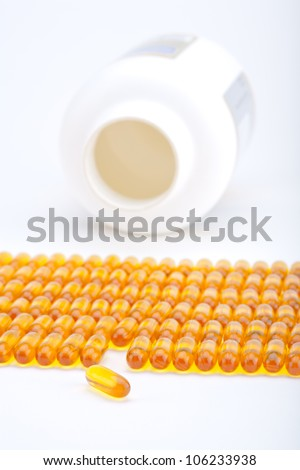 Rows of golden gel capsules - stock photo