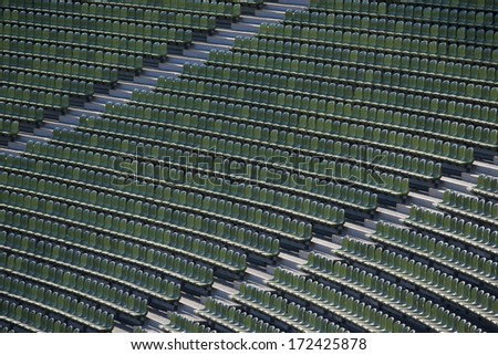 Rows of green seats in a stadium - stock photo