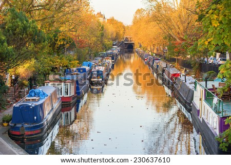 Rows of houseboats and narrow boats on the canal banks at Little Venice, Paddington, West London, on a brigh fall day - stock photo