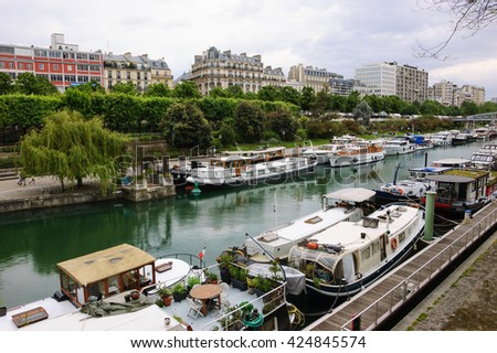 Rows of houseboats docked at  Bassin de l'Arsenal near Place de la Bastille. Paris (France). - stock photo