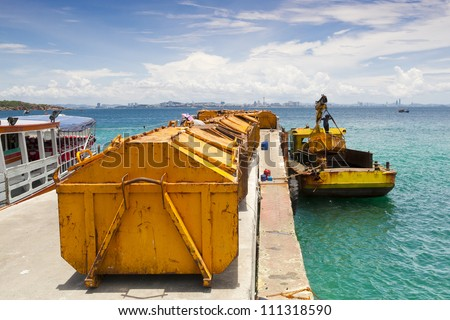 Rows of large yellow trash, the trash truck to the landfill. - stock photo