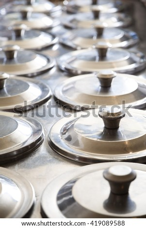 Rows Of Lids On Ice Cream Containers - stock photo