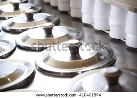 Rows Of Lids On Ice Cream Containers By Cups - stock photo