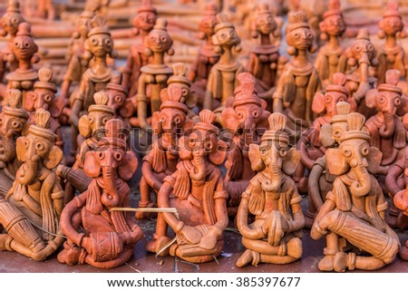 Rows of little clay puppets for sale at a handicrafts fair in Kolkata, India