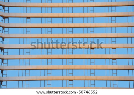 Rows Of Many Blue Windows Of Modern Building - stock photo