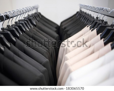 Rows of men's suit jackets - stock photo