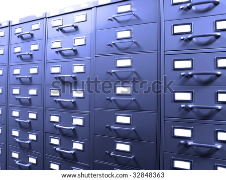 Rows of metal business filing cabinets with handles and lables