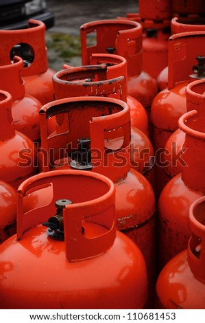 Rows of multiple red gas containers