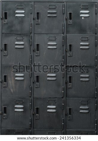 Rows of old black lockers - stock photo