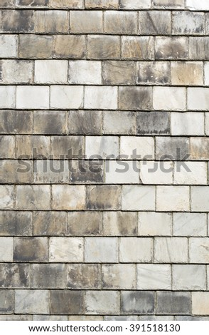 Rows of old gray roof slates close up. - stock photo