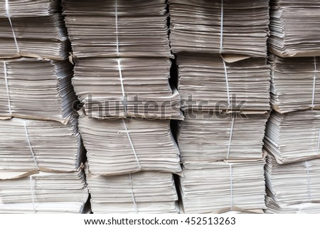 rows of piled up bundles of newspapers