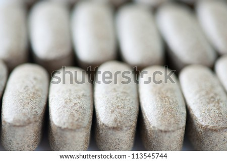 Rows of pills, close-up, shallow DOF - stock photo
