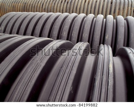 Rows of pvc drainage pipes lined up on the construction site