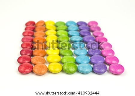 rows of rainbow colored sugar coated candies - stock photo