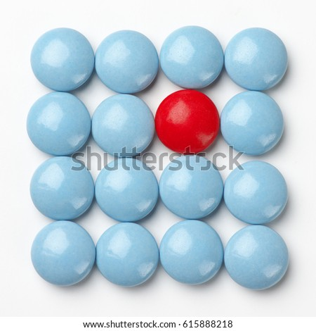 Rows of red and blue pills on white background. Top view point.
