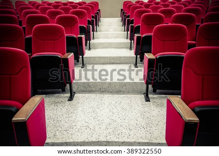 rows of red chair in the auditorium - stock photo