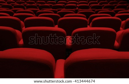 Rows Of Red Chairs In A Theater